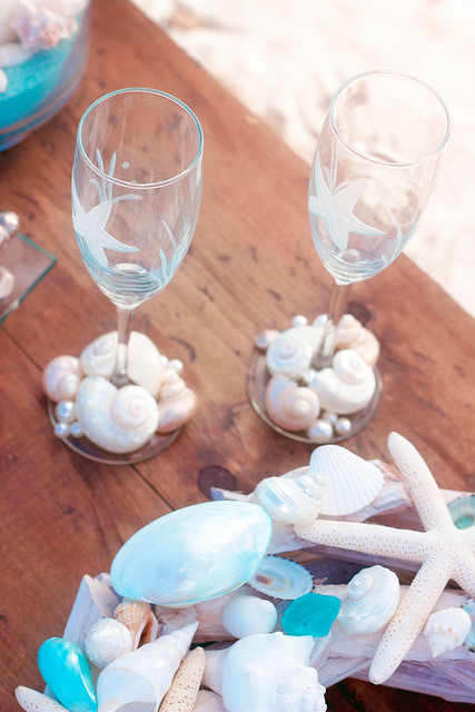 Toast the bride and groom with handmade shell and etched starfish champagne flutes...