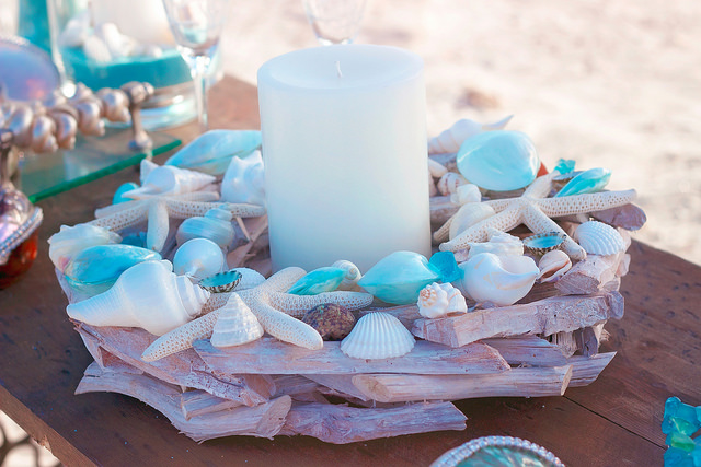 A handmade driftwood and shell wreath is the perfect centerpiece for wedding tables!