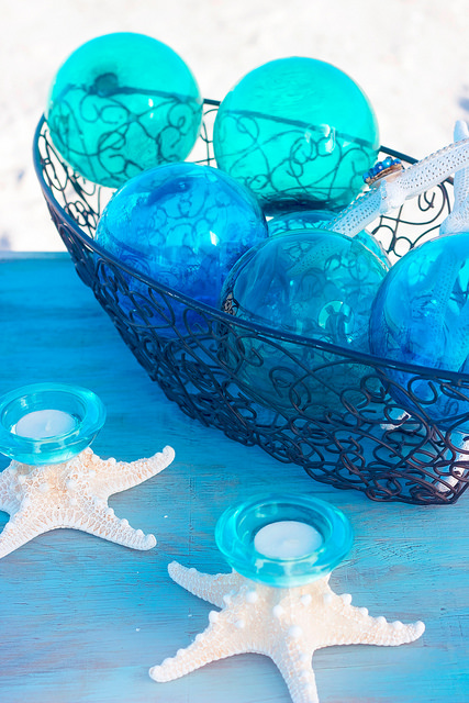 Glass floats in seaside colors, handmade starfish candleholders...